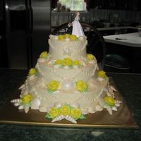 Sea Shell Wedding Cake   Shells were done with white pearl luster dust. Bride wanted yellow roses. AND they wanted that stupid cake top! Class!