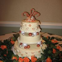Coral & Silver Seashell Wedding Cake  The bride gave me a picture of a celebrity wedding cake to copy. I really did not like this cake but it was exactly what she wanted. The...