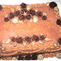 Chocolate Seashell Anniversary Cake   Chocolate cake, chocolate buttercream & roses, white chocolate shells, dusted with gold luster dust.