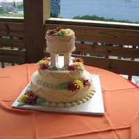 Gerber Daisy Wedding Cake  The colors the bride wanted were burnt orange, red & yellow gerber daisys. I made them from fondant with gum tex mixed in to make them...