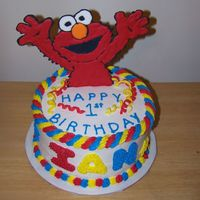 Elmo Cake   This was for a little boy's first Birthday. Elmo is made out of royal icing and the streamers are MMF.