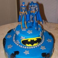 Batman Groom's Cake This was a surprise for the Groom (who is a huge Batman fan). The Bride snuck the figurines over to my house! lol. The cake is chocolate...