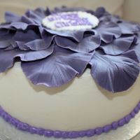 Purple Flower Birthday Cake  Vanilla cake covered with buttercream Petals were made out of fondant and placed on the cake after they were partially dried. writing was...