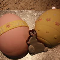 Easter Eggs   2 Easter Egg Cakes (covered in fondant) with a chocolate cookie decorated in Royal Icing.