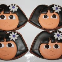 Dora Cookies   Dora the explorer cookies.Chocolate cookies cut out by hand and decorated with royal icing.