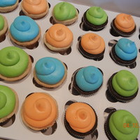 Orange, Blue, And Green   Orange, blue and green cupcakes for a baby shower.