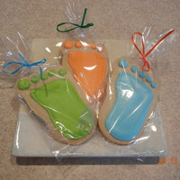 Baby Feet!   NFSC iced in Antonia's Royal Icing. Each cookie was handcut. Made for a baby shower!