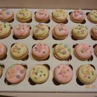 Spring Cupcakes! Pink and Yellow cupcakes with springy sprinkes!