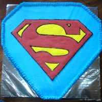 "Superman Cake WASC cake frosted with BC and ""S"" done with FBCT"