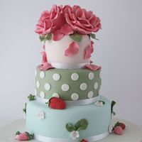Cath Kidston Cake Design of cake is inspired by Cath Kidston. Roses and strawberries is made out of modelling paste. TFL