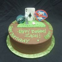 Philadelphia Sports Fanatic 10 round. Chocolate buttercream with Gumpaste sports memorabilia. Phillies, Eagles, Lombardi Trophy, Baseball and Ace of Spades card...
