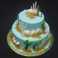 Beach Fun cake is a 10 6 round. buttercream with sanding sugar for sand, buttercream palm trees, gumpaste anchor and beach fence and white chocolate...