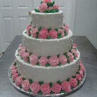 Jessica's Wedding 14 - 10 - 6. tiers all 4 1/2 inches high. all buttercream. 85 buttercream roses.
