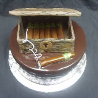 Cigar Cake For Cigar Loving Couple Groom loves cigars. Cake is a 10 inch round covered in ganache. Humidor and cigars made of fondant.
