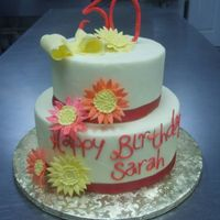 Happy 30 8-6 round. Yellow Buttercream. Gumpaste daisies and number 30. Fondant letters and ribbon.