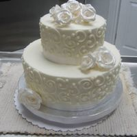 Small Scroll Cake 10 6 round. Buttercream with scrolls. Silver gumpaste roses