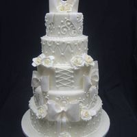 Ivory Elegance 5 tier 14-12-10-8-6 all fondant with gumpaste bows and roses. Royal Icing accents. Enjoy!