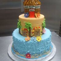 Hawaiian Theme 10 - 6 - 3 (tiki hut is 3). all buttercream some fondant accents.
