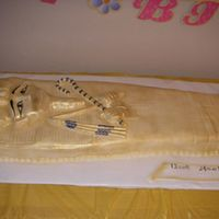 Tut_For_Web.jpg KIng Tut. Three feet long, 1 1/2 ft wide. Covered in fondant and painted gold with Lucks gold air brush.