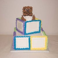 "Sherriescakemagic3.jpg 12"" square and 6 "" square with Wiltons baby bear pan on top."