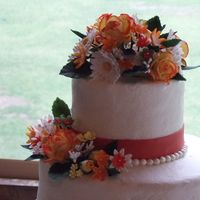 "Hook 'em Wedding Cake 14, 10, 6"" round, burnt orange cake w/ apricot filling, gumpaste flowers, chocolate pearls"