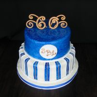 60Th Bday chocolate and vanilla tiered cake paIntbrushed in blue with gold accents in gumpaste