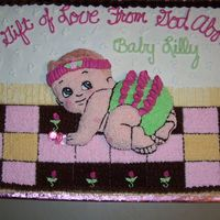 A Gift From God  A 12 by 18 cake frosted with buttercream. The baby appears to be embossed but is actually cut from a baby shaped cake pan. The only...