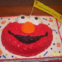 Elmo I used the Wilton's Elmo pan and placed it on a sheet cake.It was my first cake like this.