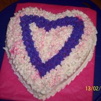 Heart Cake I made this with left over cake mix and icing from the cupcakes.....I have just started to decorated with the tips. Any suggestions would...