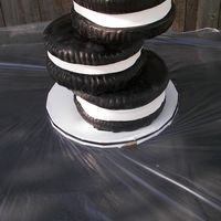 Stack Of Oreos This is chocolate cake with a layer of white cake in the middle of each one, to resemble an oreo when cut. There are oreos actually crushed...