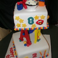 Counting Elmo The letters are wooden, the rest is cake with modeling chocolate accents and elmo.Birthday themed, one cake, 2 balloons, 3 candles, or...