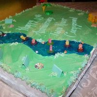 Twin River Campground 10Th Anniversary 2-12 X 18 cakes side by each, 1/2 chocolate, 1/2 vanilla. iced with butter cream, tents are made of gumpaste, all other decorations are...
