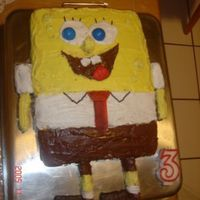 Spongebob eh, first attepmt at cake decor. before i ever heard of fondant. this is just colored buttercream frosting, nutella, sprinkles, fruit by...