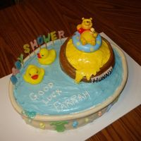 "Pooh Themed Shower Winnie the Pooh bath thermometer floating in a hunny pot (6"" round covered in fondant and food colored butter cream to make hunny.)..."