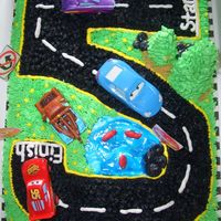 Cars Cake  I know my customer found a pic of a cake like this on this site I am just not sure who it belongs to. THANK YOU whoever you are..LOL Anyway...