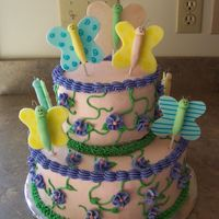 100_1408.jpg iced in buttercream with buttercream vines and flowers. fondant butterflies