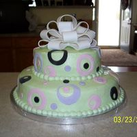 100_0211.jpg   Done for a baby shower to coordinate with the invitation. Iced in buttercream. Fondant circle cutouts and bow.