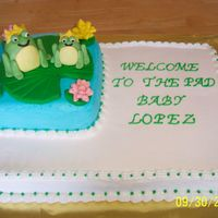 100_1145.jpg iced in buttercream. fondant frogs. made to match baby shower invitation. wish i had used more colors on it. too much white icing in my...