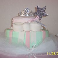 100_1329.jpg   Princess themed cake. Iced in buttercream with fondant accents.