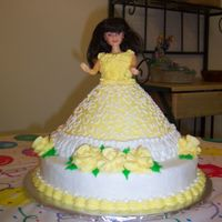 100_1369.jpg  My daughter's 2nd birthday cake. wilton wondermold pan with doll pick set on top of 10 in round. Covered in cornelli lace. Roses in...