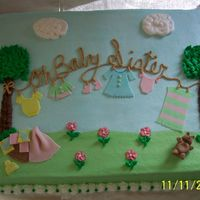 100_1336.jpg Clothesline baby shower cake. Iced in buttercream with fondant accents