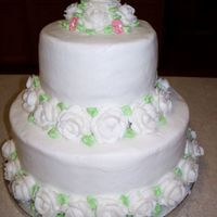 100_0221.jpg   Iced in buttercream with buttercream roses. Done for a simple bridal shower.