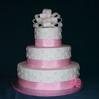 Resizeddottedswiss.jpg dummy cake done for bridal show. dotted swiss pattern, ribbon border and fondant bow