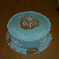Seashellbirthday.jpg   Seashell birthday cake. iced in buttercream with white chocolate seashells and graham cracker sand