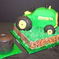 John_Deer_Tractor.jpg Babies first birthday. Since I have THE hardest time with RKT, I used bagels covered in fondant for the wheels. Smash cake was of course a...