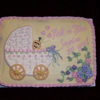 My Version Of Wilton Baby Carriage Cake This was for a celebration at work. My thanks to CC members that helped me find the inspiration picture I was looking for.