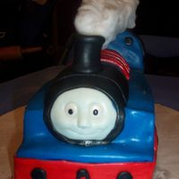 100_2905.jpg Thomas the train covered and detailed with fondant.
