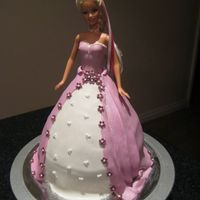 Barbie / Dolly Varden Ultimately rich choc cake, BC icing and covered in fondant.