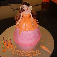 Fairy Vanilla sponge cake. This was done for my daughter. She only had 2 requests..1)orange and 2) fairy.