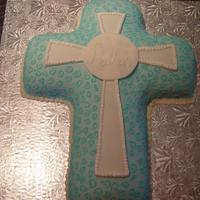 Baptism Cross   Made two cross cakes for a twins baptism. The mom picked the design from the Wilton website. The original design by Wilton is in blue.